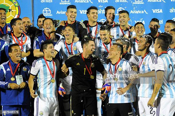 Players of Argentina celebrate after winning the title at the end of the a match between Argentina and Uruguay as part of South American U20 at...