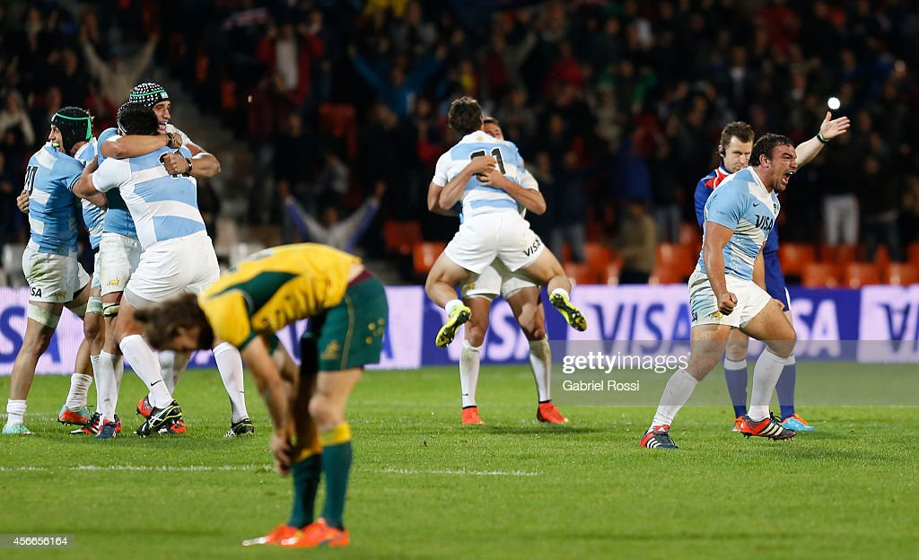 Players of Argentina celebrate at the end of a match between Argentina Los Pumas and Australia Wallabies as part of The Rugby Championship 2014 at...