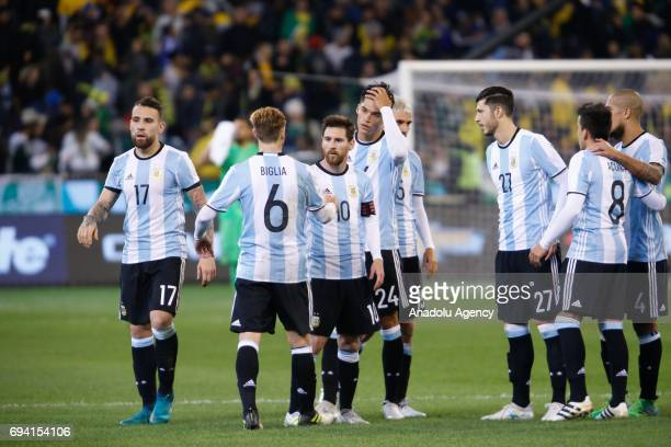 Players of Argentina celebrate each other during a friendly football international between Argentina and Brazil at the Melbourne Cricket Ground in...