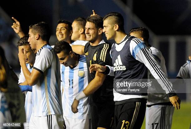 Players of Argentina celebrate the victory after a match between Argentina and Brazil as part of South American U20 at Parque Central Stadium on...