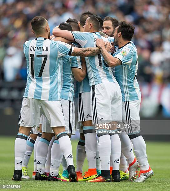Players of Argentina celebrate their first goal scored by Erik Lamela during a group D match between Argentina and Bolivia at CenturyLink Field as...