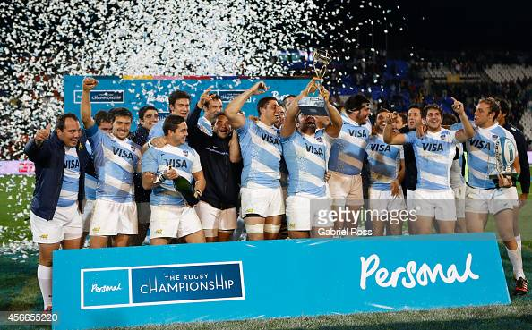 Players of Argentina celebrate with the trophy after winning a match between Argentina Los Pumas and Australia Wallabies as part of The Rugby...