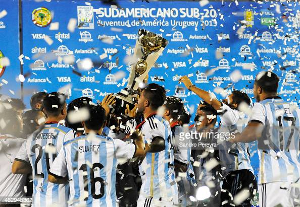 Players of Argentina celebrate with the trophy after winning the title at the end of the a match between Argentina and Uruguay as part of South...