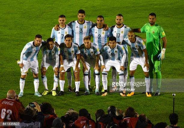 Players of Argentina pose for pictures before the start of their 2018 World Cup football qualifier match against Uruguay in Montevideo on August 31...
