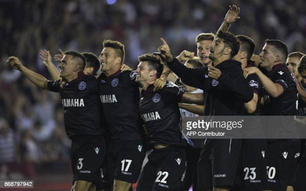 Players of Argentina's Lanus celebrate after defeating Argentina's River Plate 42 during their Copa Libertadores semifinal second leg football match...