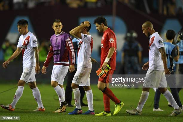 Players of Argentine team River Plate leave the field in dejection after losing 42 to Argentina's Lanus in their Copa Libertadores semifinal second...
