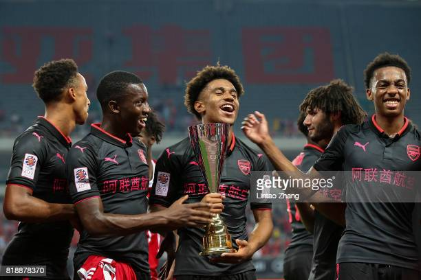 Players of Arsenal celebrate winning the the 2017 International Champions Cup football match between FC Bayern and Arsenal FC at Shanghai Stadium on...