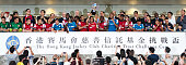 Players of Arsenal FC celebrate with trophy at the end of the preseason Asian Tour friendly match between Kitchee FC and Arsenal at Hong Kong Stadium...