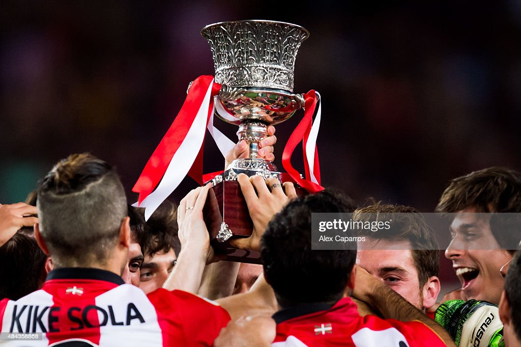 Players of Athletic Club celebrate with the Spanish Super Cup trophy after the Spanish Super Cup second leg match between FC Barcelona and Athletic...