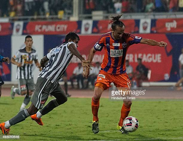 Players of Atletico de Kolkata and FC Pune City in action during an Indian Super League 2015 match at Shree Shiv Chhatrapati Sports Complex on...
