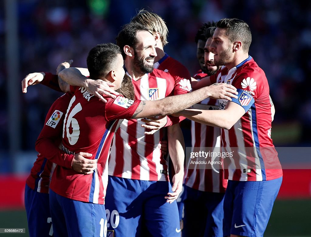 Players of Atletico Madrid celebrate their team's goal during the La Liga football match between Atletico Madrid and Rayo Vallecano at Vicente Calderon, in Madrid, Spain on April 30, 2016.