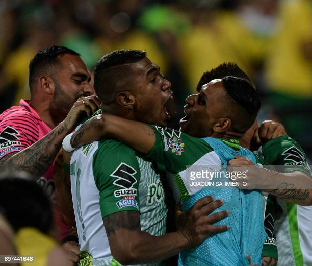 Players of Atletico Nacional celebrate after teammate Dayro Moreno scored against Deportivo Cali during the Colombian Apertura football league...