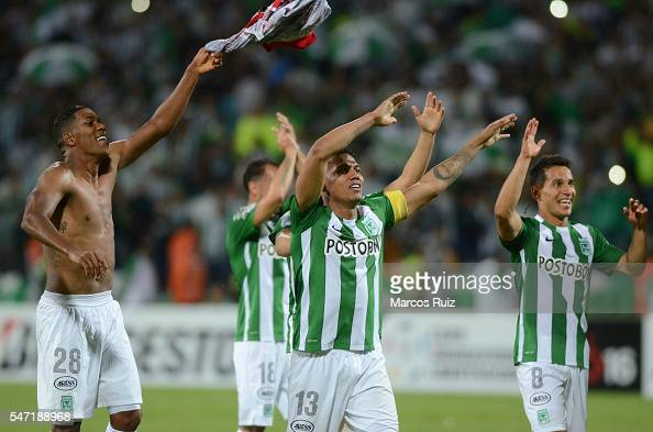 Players of Atletico Nacional celebrate after winning a second leg semi final match between Atletico Nacional and Sao Paulo as part of Copa...