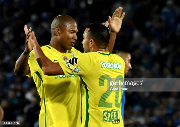 Players of Atletico Nacional celebrate their victory at the end of the match between Millonarios and Atletico Nacional as part of the Liga Aguila I...