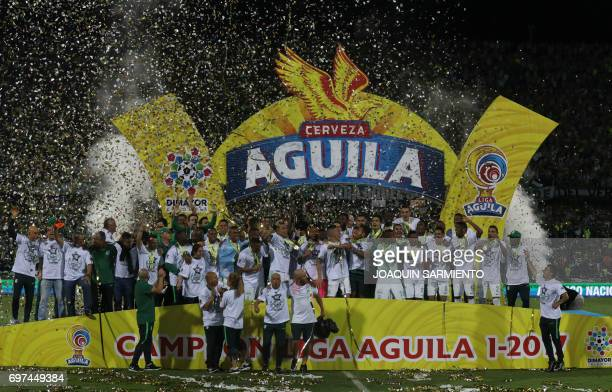 Players of Atletico Nacional celebrate with the trophy after winning the Colombian Apertura football league tournament by defeating Deportivo Cali 51...