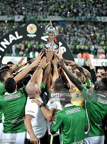 Players of Atletico Nacional lift the champions trophy after winning the final second leg match between Atletico Nacional and Independiente del Valle...