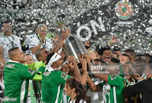 Players of Atletico Nacional lift the trophy after a second leg final match between Atletico Nacional and Independiente del Valle as part of Copa...