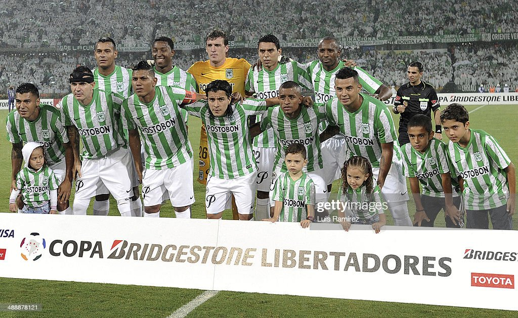 Players of Atletico Nacional pose for a photo before a quarterfinal match between Atletico Nacional and Defensor Sporting as part of Copa Bridgestone Libertadores 2014 at Atanasio Girardot Stadium on May 08, 2014 in Medellin, Colombia.