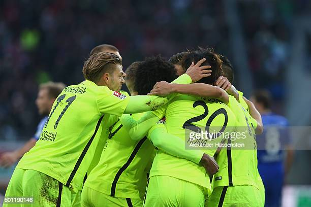 Players of Augsburg celebrate the first team goal during the Bundesliga match between FC Augsburg and FC Schalke 04 at WWK Arena on December 13 2015...