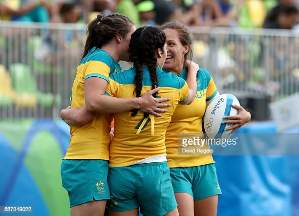 Players of Ausrtralia celebrate during the Women's Semi Final 1 Rugby Sevens match between Australia and Canada on Day 3 of the Rio 2016 Olympic...