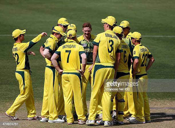 Players of Australia celebrate during the ICC U19 Cricket World Cup 2014 Semi Final match between South Africa and Australia at the Dubai Sports City...
