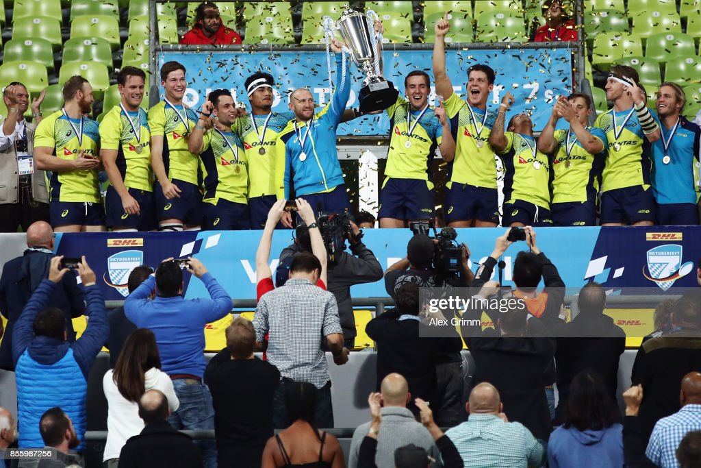 Players of Australia celebrate with the trophy after winning the final against Fiji on Day 2 of the Rugby Oktoberfest 7s tournament at Olympiastadion on September 30, 2017 in Munich, Germany.