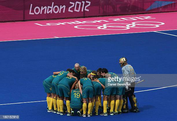 Players of Australia huddle during the Men's Hockey bronze medal match against Great Britain on Day 15 of the London 2012 Olympic Games at Hockey...