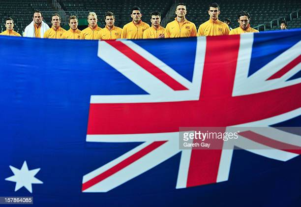 Players of Australia line for the national anthem ahead of the EAFF East Asian Cup 2013 Qualifying match between Guam and Australia at Hong Kong...