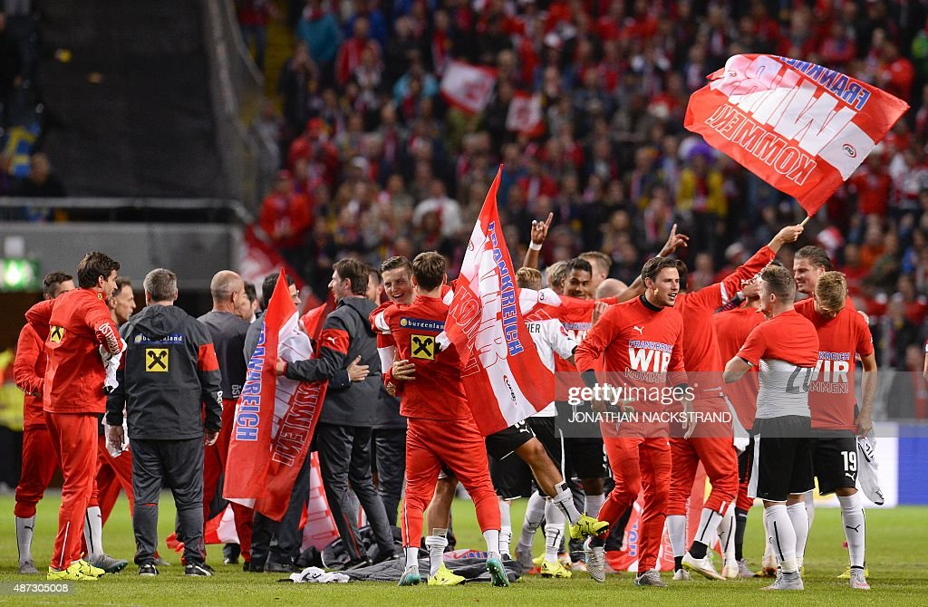 Players of Austria celebrate after winning the Euro 2016 qualifying group G football match between Sweden and Austria at the Friends Arena in Solna...