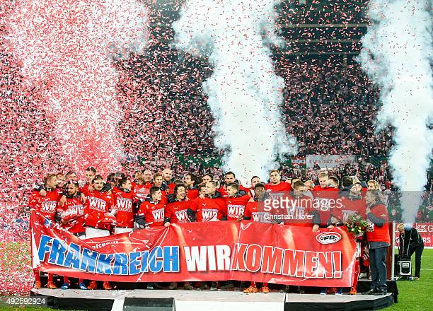 Players of Austria celebrate with a banner reading `France we are coming` after winning the UEFA EURO 2016 Qualifier between Austria and...