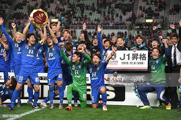 Players of Avispa Fukuoka celebrate the promotion to J1 with lifting the J1 PlayOff Winners Plate during the JLeague 2 2015 Promotional PLayoff Final...