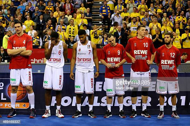 Players of Bamberg look dejected after losing the BEKO BBL Top Four final game between EWE Baskets Oldenburg and Brose Baskets Bamberg at Ewe Arena...
