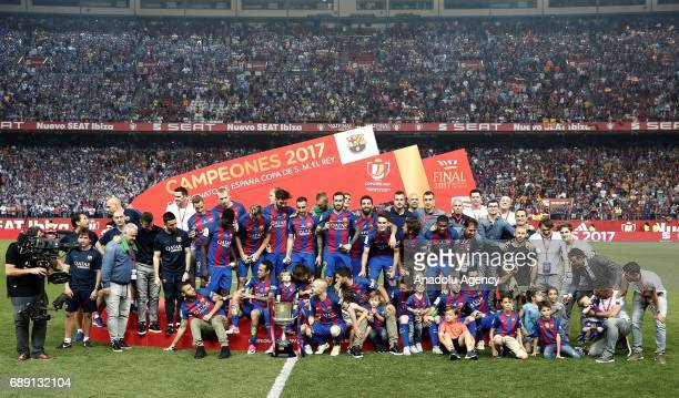 Players of Barcelona celebrate with the trophy after the Copa Del Rey Final between FC Barcelona and Deportivo Alaves at Vicente Calderon Stadium on...