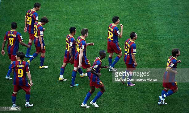 Players of Barcelona walk after the celebrate the fisrt goal during the La Liga match between Malaga and Barcelona at La Rosaleda Stadium on May 21...