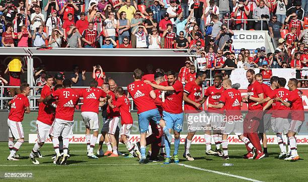 Players of Bayern Muenchen celebrate their German Championship title after the Bundesliga match between FC Bayern Muenchen and FC Ingolstadt at Audi...