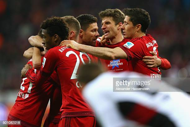 Players of Bayern Muenchen celebrates the 2nd team goal whilst Robert Bauer of Ingolstadt reacts during the Bundesliga match between FC Bayern...