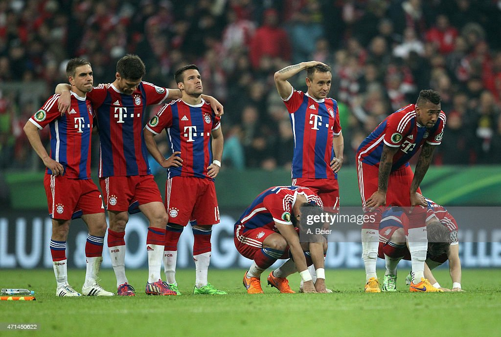 Players of Bayern Muenchen react after a missed penalty goal during the penalty shoot-out of the DFB Cup semi final match between FC Bayern Muenchen and Borussia Dortmund at Allianz Arena on April 28, 2015 in Munich, Germany.