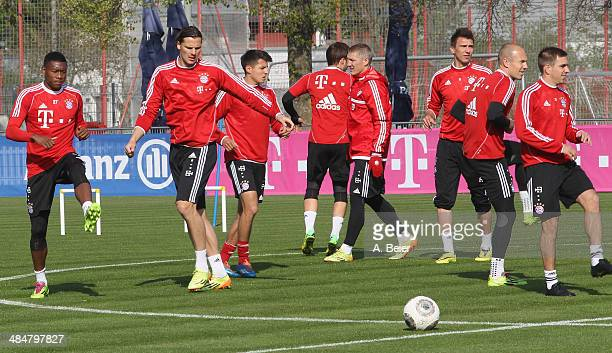 Players of Bayern Muenchen warm up during the FC Bayern Muenchen training session at Bayern's training ground Saebener Strasse on April 14 2014 in...