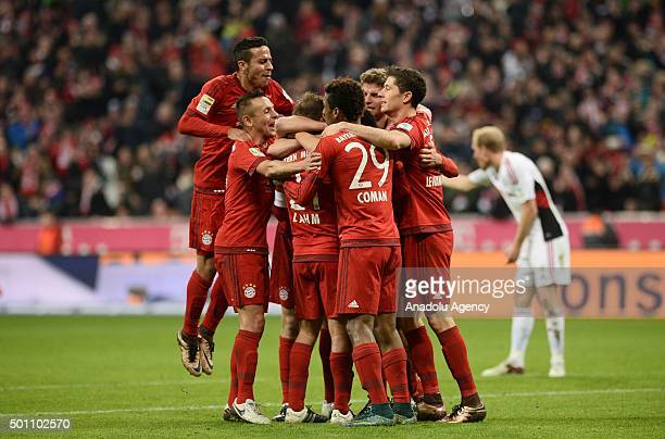 Players of Bayern Munich celebrate scoring during the Bundesliga soccer match between FC Bayern Munich and FC Ingolstadt 04 at the Allianz Arena on...
