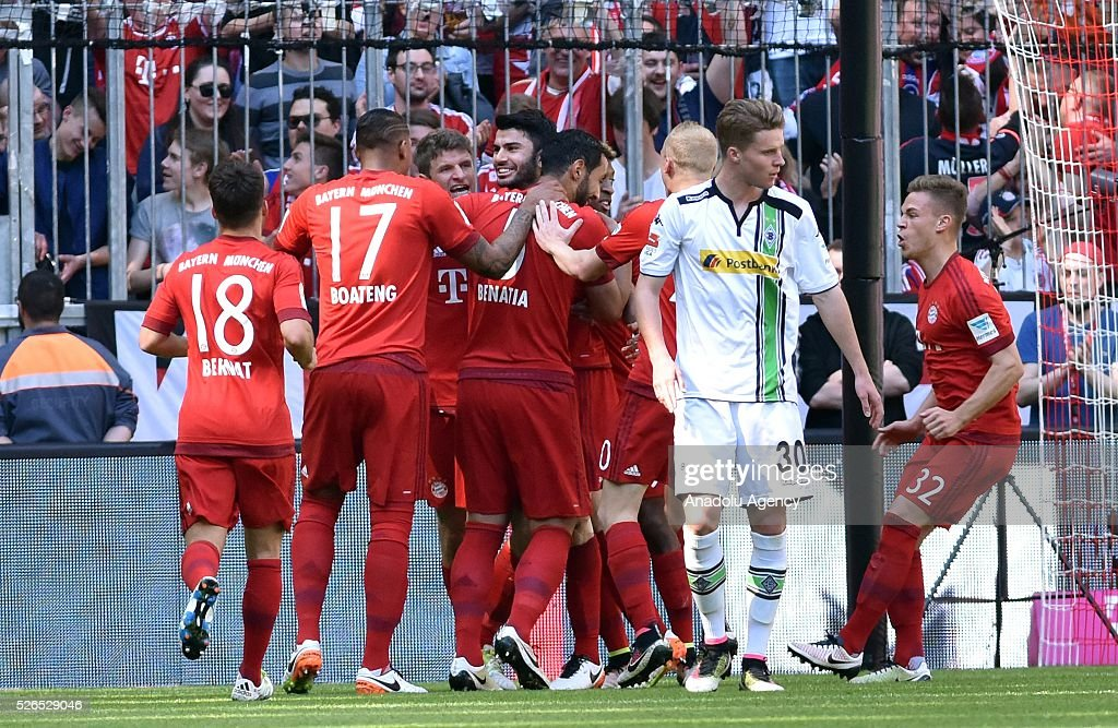 Players of Bayern Munich celebrate their team's first goal during the Bundesliga soccer match between Bayern Munich and Borussia Moenchengladbach at the Allianz Arena in Munich, Germany on April 30, 2016.