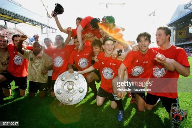 Players of Bayern Munich present a mock German soccer championship trophy after the Bundesliga match between 1 FC Kaiserslautern and FC Bayern Munich...