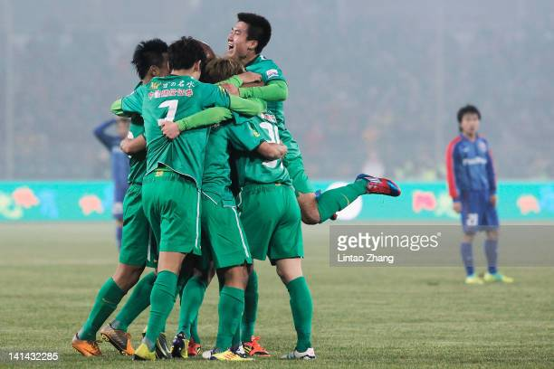 Players of Beijing Guoan celebrate a goal during the Chinese Super League match against Shanghai Shenhua at Workers Stadium on March 16 2012 in...