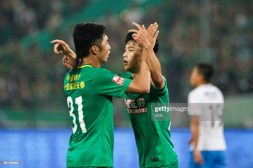Players of Beijing Guoan celebrate a point during the 13th round match of 2017 Chinese Football Association Super League (CSL) between Beijing Guoan and Tianjin Teda at Beijing Workers' Stadium on June 18, 2017 in Beijing, China.