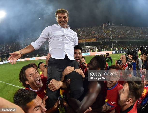 Players of Benevento Calcio celebrate the victory with their coach Marco Baroni after the Serie B Play off Final match between Benevento Calcio and...