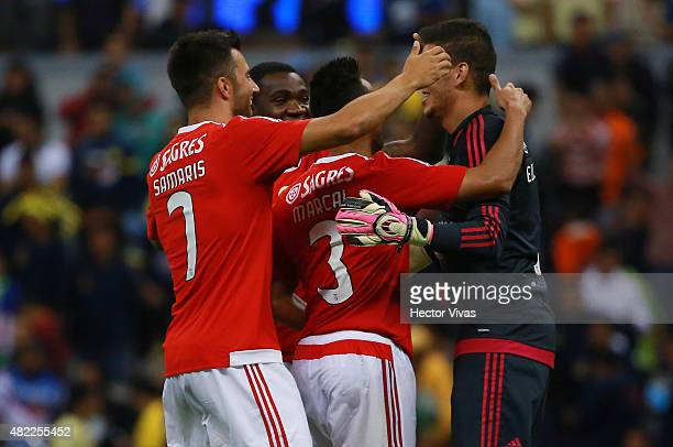 Players of Benfica celebrate with Ederson Moraes goalkeeper of Benfica after winning in a penalty shootout against America as part of the...