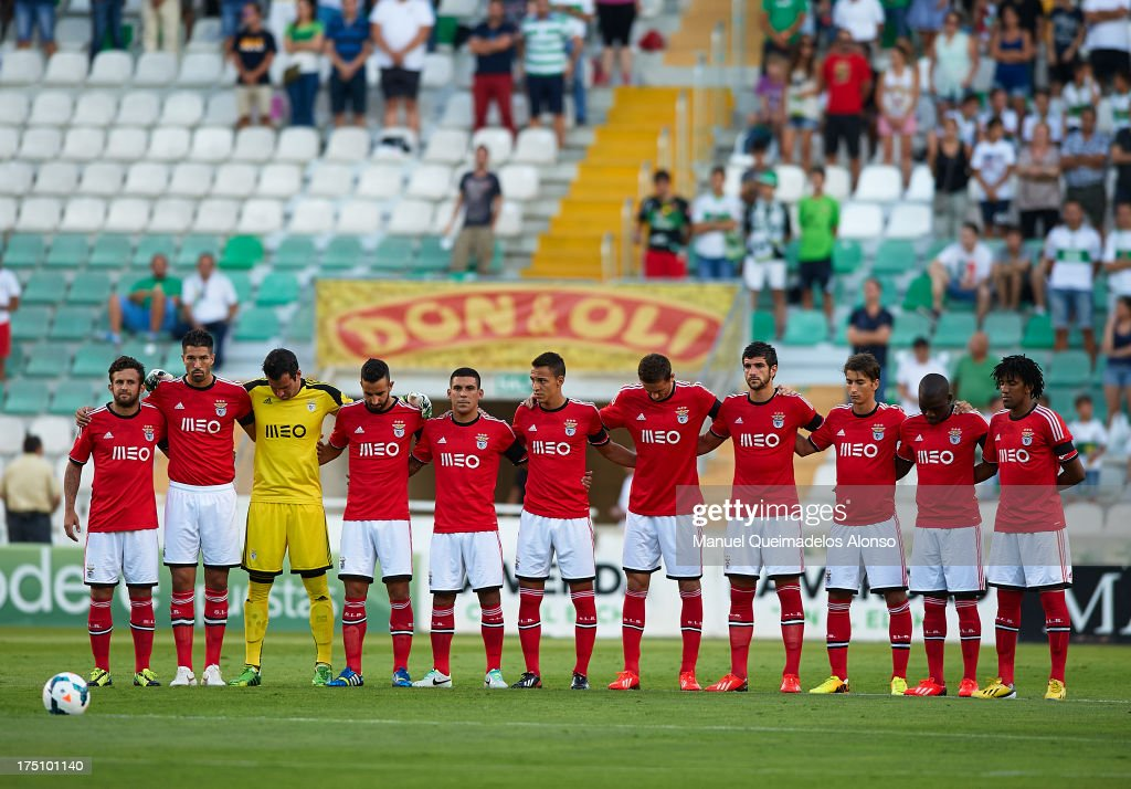 Players of Benfica observe a minute's silence to pay respect to victims of the Galicia rail derailment that killed 78 on Wednesday, prior to the start of the friendly match between Elche CF and Benfica at Estadio Martinez Valero on July 31, 2013 in Elche, Spain.