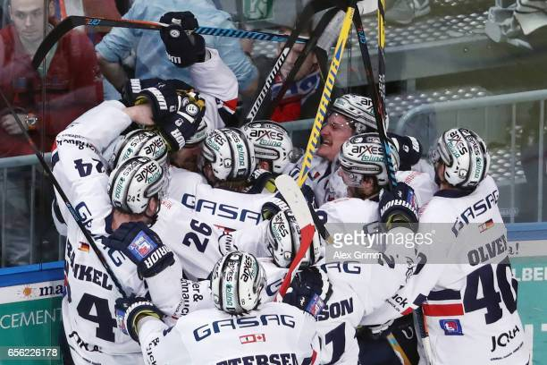 Players of Berlin celebrate after winning the DEL Playoffs quarter finals Game 7 between Adler Mannheim and Eisbareren Berlin at SAP Arena on March...