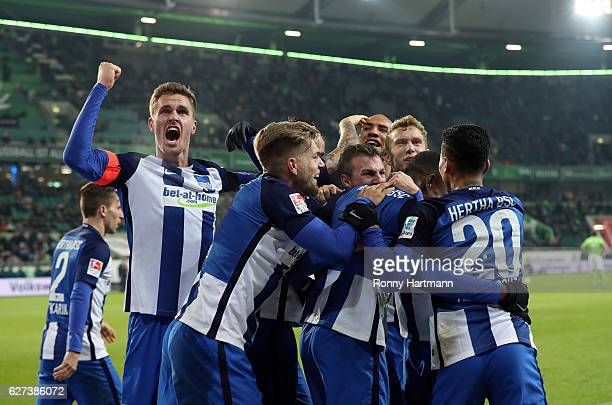 Players of Berlin celebrate their team's third goal during the Bundesliga match between VfL Wolfsburg and Hertha BSC at Volkswagen Arena on December...
