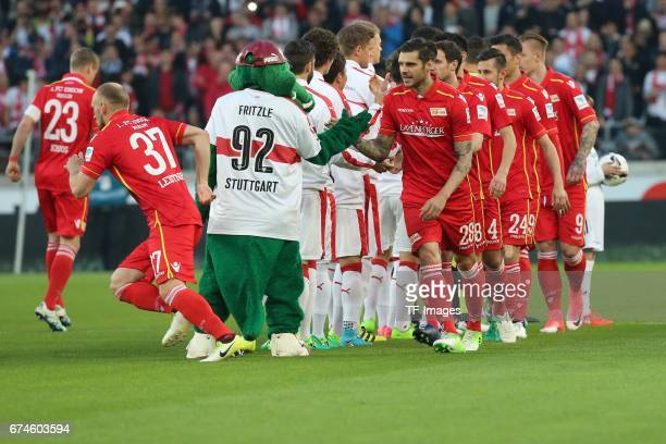 Players of Berlin shakes hands with players of Stuttgart during the Second Bundesliga match between VfB Stuttgart and 1 FC Union Berlin at...