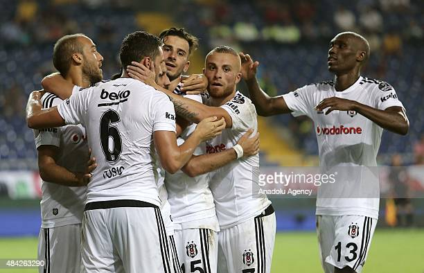 Players of Besiktas celebrate after a goal during the Turkish Spor Toto Super League football match between Mersin Idmanyurdu and Besiktas at Mersin...